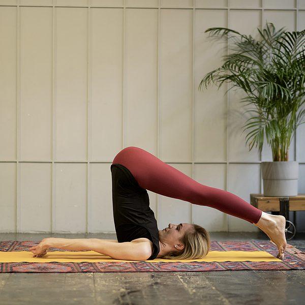 Woman teaching yoga wellness class