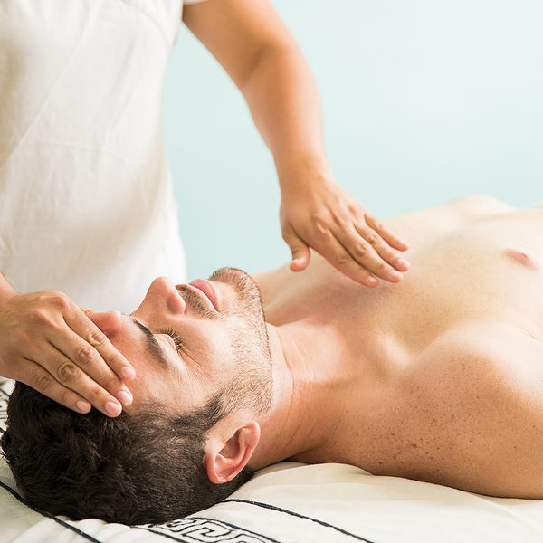 Holistic therapist treating a young man